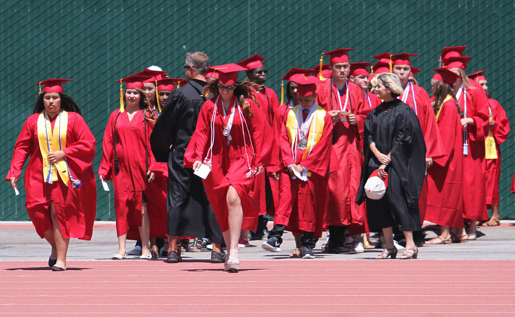 . Graduate candidates walk up to the stage during Lakewood High School\'s commencement Thursday at Veterans Memorial Stadium in Long Beach, CA Thursday, June 12, 2014. (Photo by Mark Dustin for the Press-Telegram)