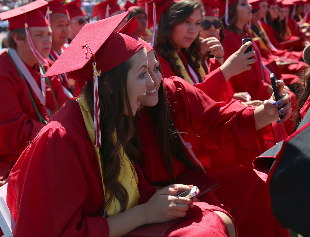 . Graduate candidates pose for a selfie during Lakewood High School\'s commencement Thursday at Veterans Memorial Stadium in Long Beach, CA Thursday, June 12, 2014. (Photo by Mark Dustin for the Press-Telegram)