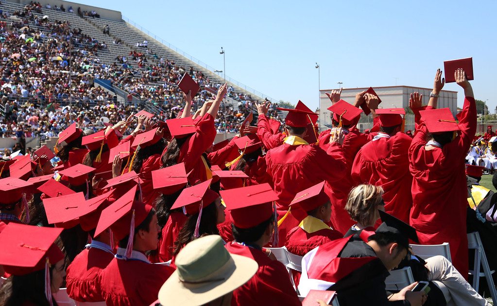 . Graduate candidates do the wave during Lakewood High School\'s commencement Thursday at Veterans Memorial Stadium in Long Beach, CA Thursday, June 12, 2014. (Photo by Mark Dustin for the Press-Telegram)