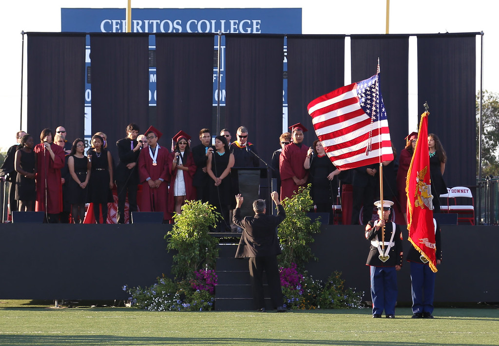 . The Downey High School Jazz Choir performs the National Anthem during Downey High School\'s 111th Commencement Ceremony Wednesday evening in Falcon Stadium at Cerritos College in Norwalk, CA Wednesday, June 18, 2014. (Photo by Mark Dustin for the Press-Telegram)