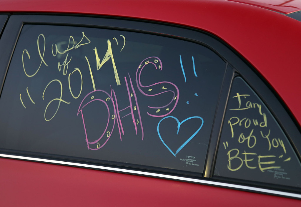 . Car window decorated in honor of Downey High School\'s Class of 2014 during Downey High School\'s 111th Commencement Ceremony Wednesday evening in Falcon Stadium at Cerritos College in Norwalk, CA Wednesday, June 18, 2014. (Photo by Mark Dustin for the Press-Telegram)