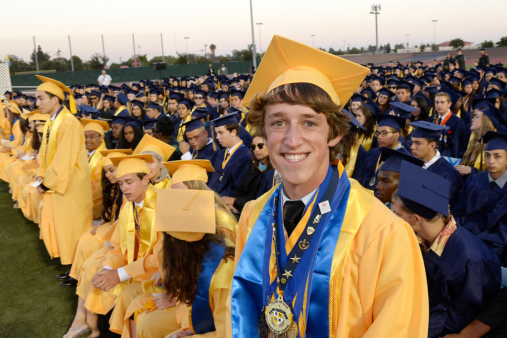. LONG BEACH - 06/12/2014 - (Mark Savage) Millikan High School Graduation at Veterans Memorial Stadium. Thomas Luka lifts his friend Brian Bowser after he receives his diploma.