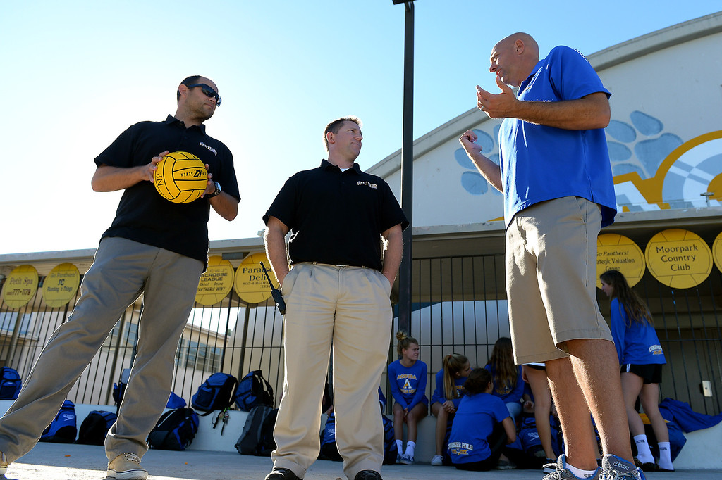 . Newbury Park girls\' water polo coach Dave Gleisberg, left, and Agoura girls\' water polo coach Jason Rosenthal, right, talk before their match, Wednesday, January 29, 2014, at Newbury Park. (Photo by Michael Owen Baker/L.A. Daily News)