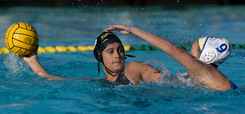 . Newbury Park\'s Anjali Paramanandam is pressured by Agoura\'s Taylor Shershenovich, Wednesday, January 29, 2014, at Newbury Park. (Photo by Michael Owen Baker/L.A. Daily News)