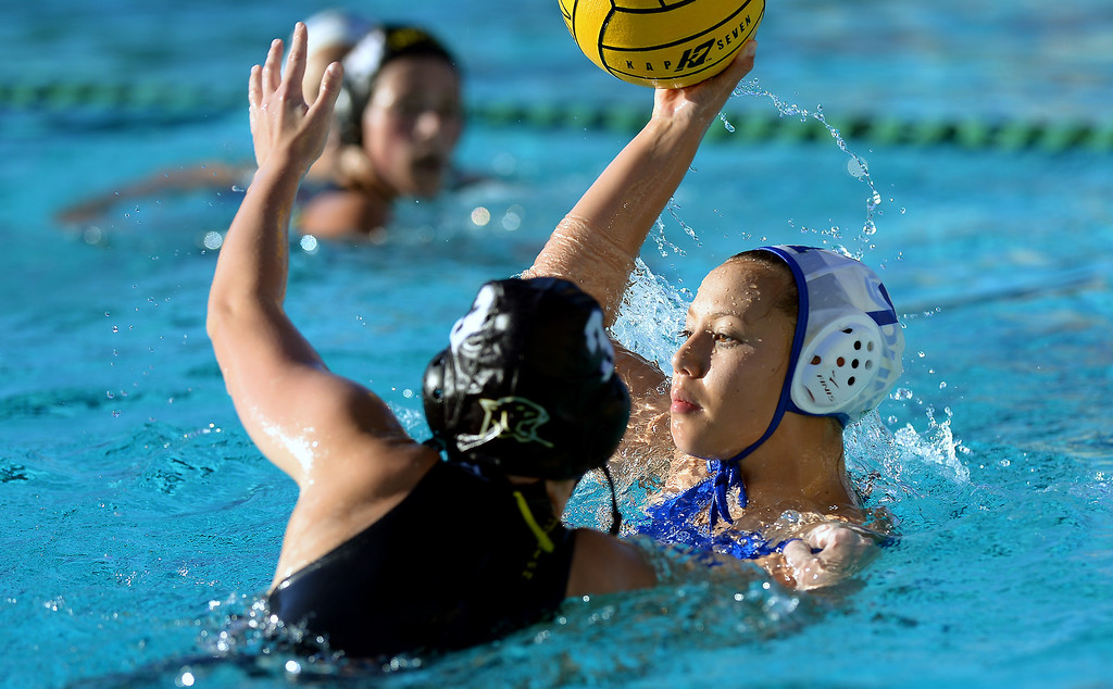 . Agoura\'s Emily Spaeter passes under pressure from Newbury Park\'s Cambria MIddleton, Wednesday, January 29, 2014, at Newbury Park. (Photo by Michael Owen Baker/L.A. Daily News)