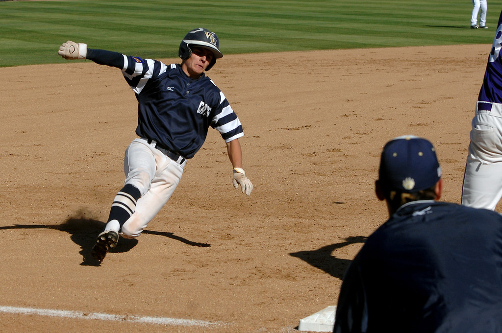 . West Ranch\'s Jake Spurlin tries to stretch his hit into a triple that scored two runs against Valencia in their Foothill League opener, Wednesday, March 19, 2014, at Valencia. (Photo by Michael Owen Baker/L.A. Daily News)