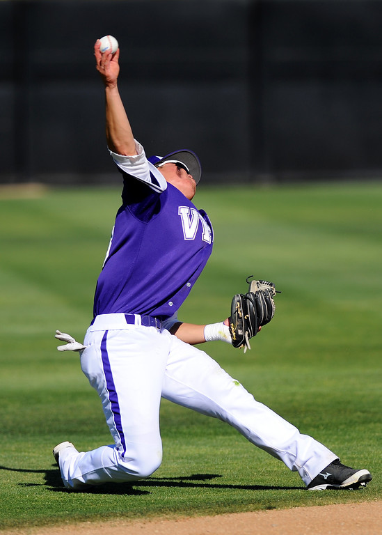 . Valencia shortstop Keston Hiura throws to first on an infield hit by West Ranch in their Foothill League opener, Wednesday, March 19, 2014, at Valencia. (Photo by Michael Owen Baker/L.A. Daily News)