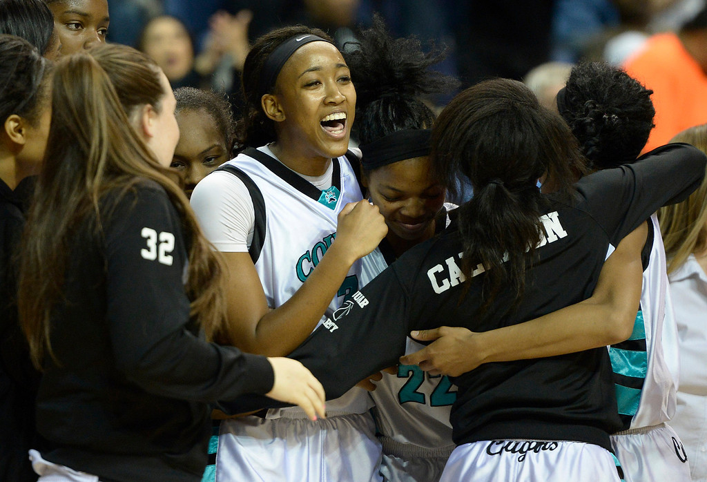 . Canyon Springs celebrates after they defeated Alemany 66-51 in the Girls Division I Final game played at Citizens Bank in Ontario, CA. March 22, 2014 (Photo by John McCoy / Los Angeles Daily News)