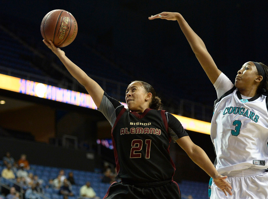 . Alemany#21 Breana Calhoun gets past Canyon Springs#3 Cheyenne Greenhouse for a layup. Canyon Springs defeated Alemany 66-51 in the Girls Division I Final game played at Citizens Bank in Ontario, CA. March 22, 2014 (Photo by John McCoy / Los Angeles Daily News)