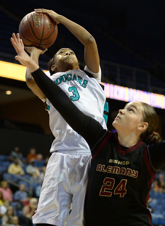 . Canyon Springs#3 Cheyenne Greenhouse shoots over Alemany#24 Hannah Johnson. Canyon Springs defeated Alemany 66-51 in the Girls Division I Final game played at Citizens Bank in Ontario, CA. March 22, 2014 (Photo by John McCoy / Los Angeles Daily News)
