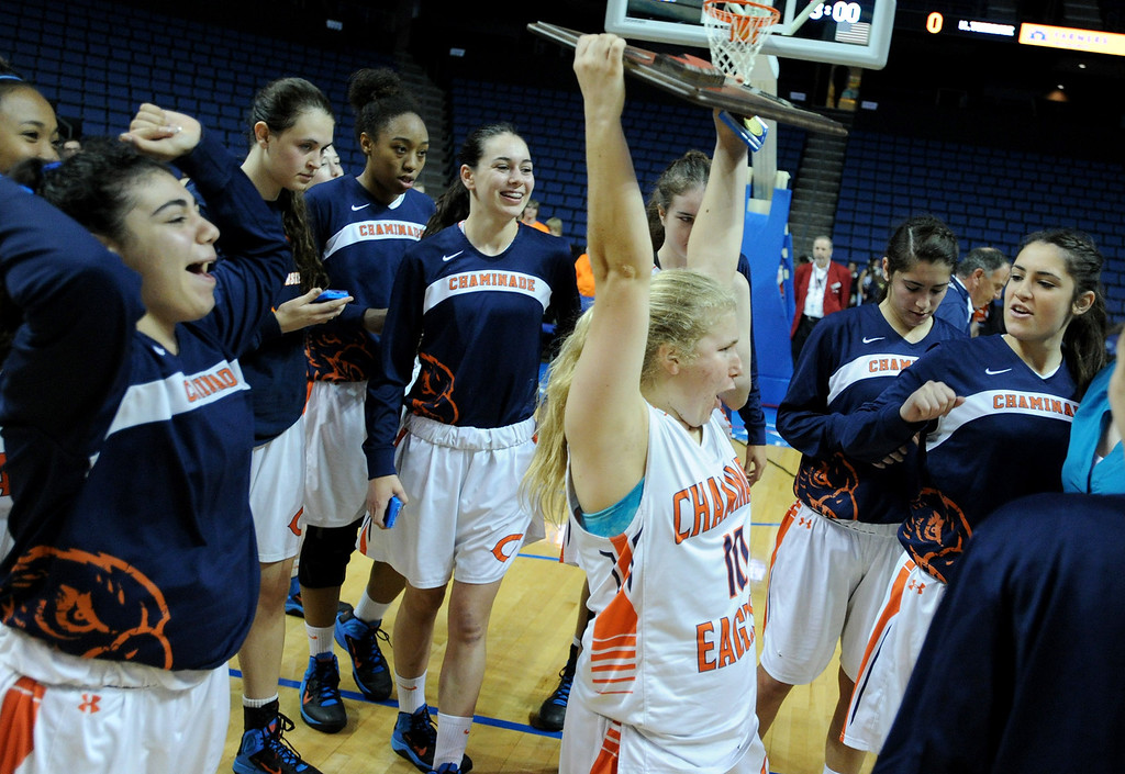. Chaminade#10 Paige Fecske hoists the championship plaque. Chaminade defeated West High School 67-50 in the Girls Division II Final game played at Citizens Bank in Ontario, CA. March 22, 2014 (Photo by John McCoy / Los Angeles Daily News)