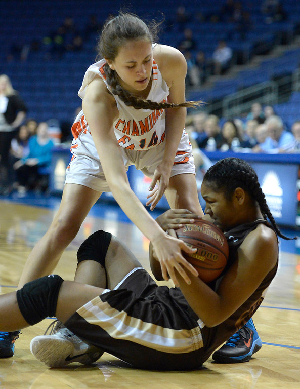 . Chaminade#44 Priscilla Romofsky tries to strip the ball away from West#20 Jasmine Jones. Chaminade defeated West High School 67-50 in the Girls Division II Final game played at Citizens Bank in Ontario, CA. March 22, 2014 (Photo by John McCoy / Los Angeles Daily News)