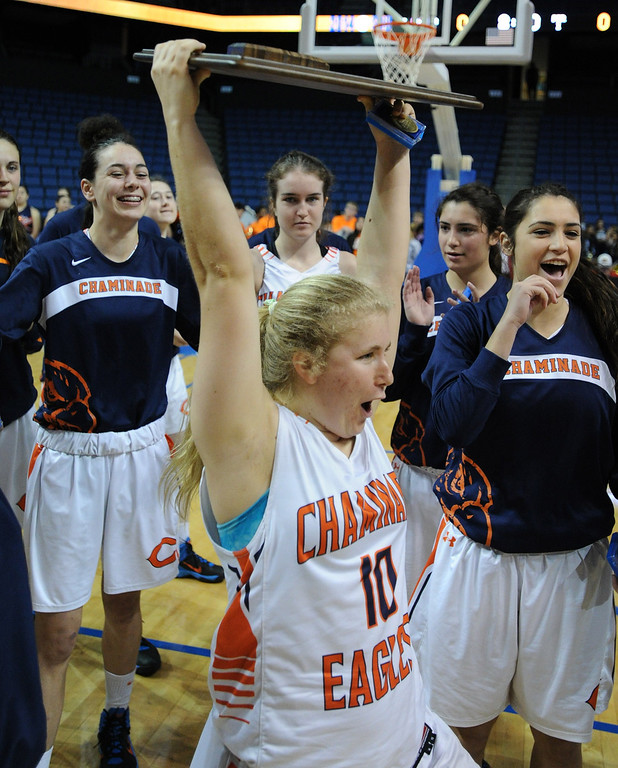 . Chaminade#10 Paige Fecske holds up the championship plaque. Chaminade defeated West High School 67-50 in the Girls Division II Final game played at Citizens Bank in Ontario, CA. March 22, 2014 (Photo by John McCoy / Los Angeles Daily News)