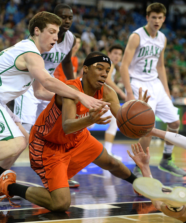 . Chaminade\'s Trevor Stanback and Sir Francis Drake\'s Dane Wells go for a loose ball in the CIF-State Division III Finals because of illness, Friday, March 28, 2014, in Sacramento. (Photo by Michael Owen Baker/L.A. Daily News)