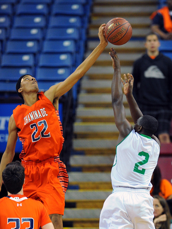 . Chaminade\'s Trevor Stanback blocks a shot by Sir Francis Drake\'s Malik Huff in the CIF-State Division III Finals because of illness, Friday, March 28, 2014, in Sacramento. (Photo by Michael Owen Baker/L.A. Daily News)