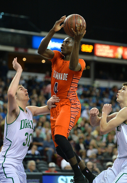 . Chaminade\'s Michael Oguine takes the ball to the hoop between Sir Francis Drake\'s Jesse Hunt, left, and Jasper Verduin in the CIF-State Division III Finals, Friday, March 28, 2014, in Sacramento. (Photo by Michael Owen Baker/L.A. Daily News)
