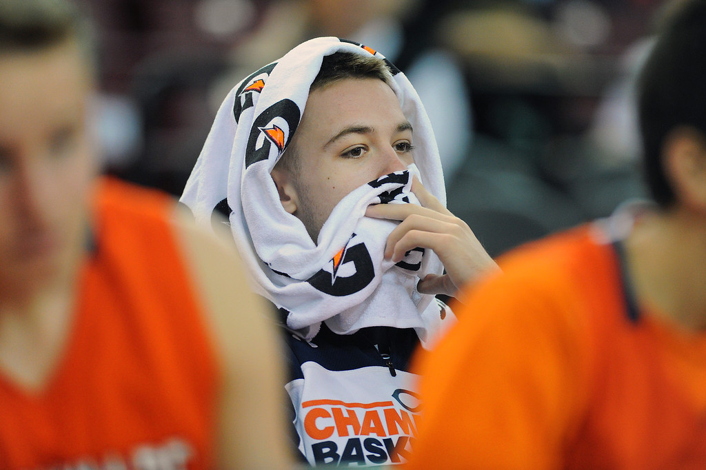 . Chaminade\'s Jack Williams watches the CIF-State Division III Finals from behind the bench with a towel over his head because of illness, Friday, March 28, 2014, in Sacramento. (Photo by Michael Owen Baker/L.A. Daily News)