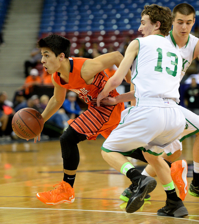 . Chaminade\'s Dylan Cuenca dribbles out of the double team by Sir Francis Drake\'s  in the CIF-State Division III Finals. (Photo by Michael Owen Baker/L.A. Daily News)