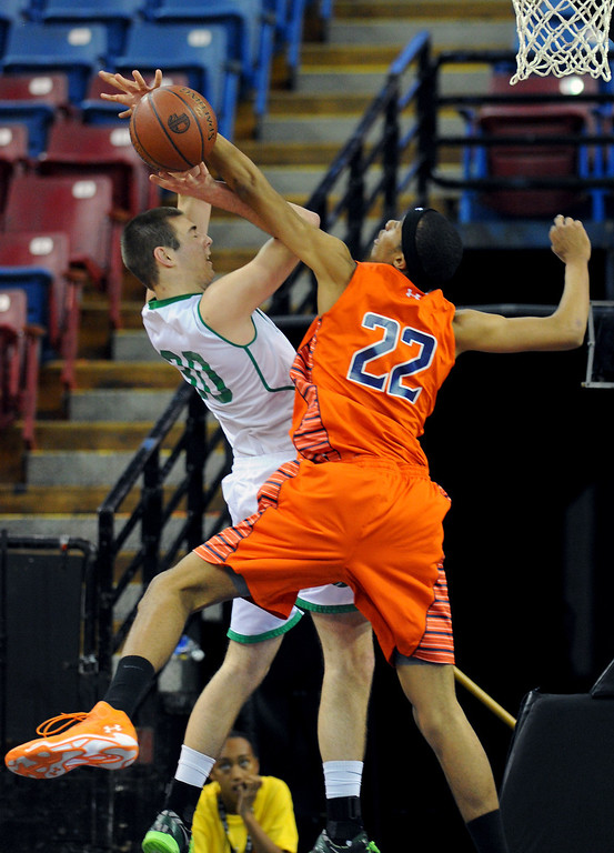 . Chaminade\'s Trevor Stanback blocks a shot by Sir Francis Drake\'s Jesse Hunt in the CIF-State Division III Finals because of illness, Friday, March 28, 2014, in Sacramento. (Photo by Michael Owen Baker/L.A. Daily News)