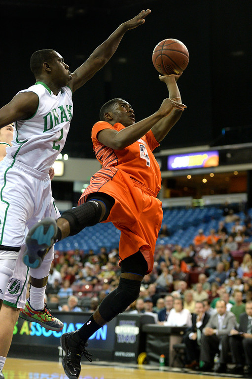 . Chaminade\'s Michael Oguine shoots against Sir Francis Drake\'s Malik Huff in the CIF-State Division III Finals, Friday, March 28, 2014, in Sacramento. (Photo by Michael Owen Baker/L.A. Daily News)