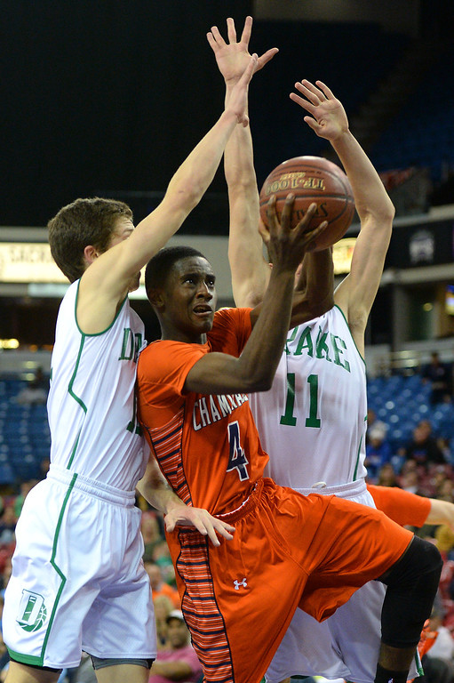 . Chaminade\'s Michael Oguine takes the ball to the hoop between Sir Francis Drake\'s Sam Dines, left, and Jasper Verduin in the CIF-State Division III Finals, Friday, March 28, 2014, in Sacramento. (Photo by Michael Owen Baker/L.A. Daily News)