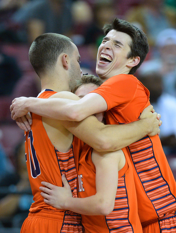 . Chaminade\'s Joel Loth, from left, Daniel Holcomb and Jake Porath have a group hug after beating Sir Francis Drake 71-51 in the CIF-State Division III Finals because of illness, Friday, March 28, 2014, in Sacramento. (Photo by Michael Owen Baker/L.A. Daily News)