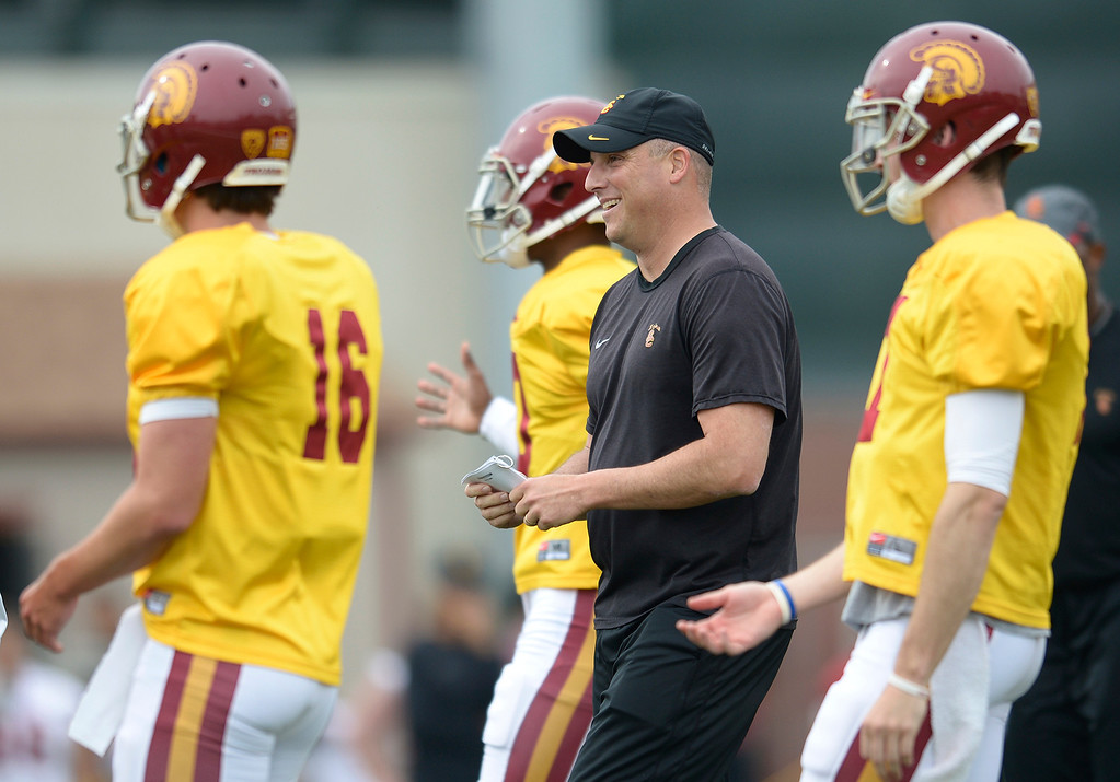. QB coach Clay Helton with his troops. The coaches at USC are running the Trojans through their paces with spring practices on the school campus. Los Angeles, CA. 4/10/2014(Photo by John McCoy / Los Angeles Daily News)