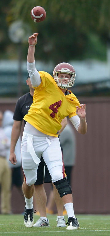 . Max Browne launches a pass. The coaches at USC are running the Trojans through their paces with spring practices on the school campus. Los Angeles, CA. 4/10/2014(Photo by John McCoy / Los Angeles Daily News)
