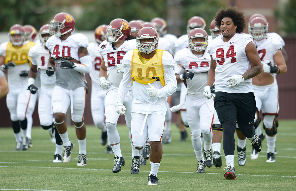 . Defensive players head onto the practice field. The coaches at USC are running the Trojans through their paces with spring practices on the school campus. Los Angeles, CA. 4/10/2014(Photo by John McCoy / Los Angeles Daily News)