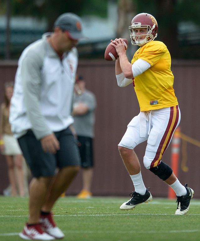 . Coach Steve Sarkisian runs a pass route while QB Max Browne gets ready to fire away. The coaches at USC are running the Trojans through their paces with spring practices on the school campus. Los Angeles, CA. 4/10/2014(Photo by John McCoy / Los Angeles Daily News)