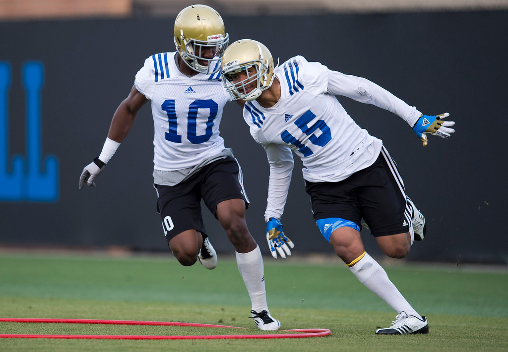 . UCLA defensive backs Priest Willis #15 and Fabian Moreau #10 during football practice at Spaulding Field on the UCLA campus Monday, April 21, 2014. (Photo by Hans Gutknecht/Los Angeles Daily News)