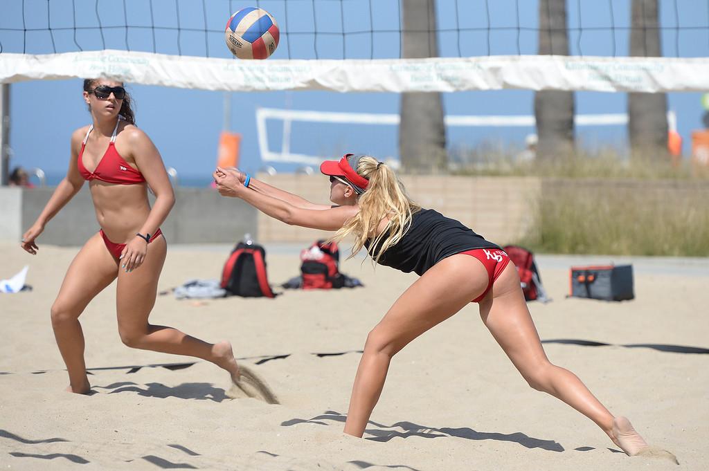 . (l-r) Dominique Dodd and Abril Bustamante play against Huntington Beach. Interscholastic Beach Volleyball League postseason tournament. Santa Monica, CA. 5/10/2014(Photo by John McCoy / Los Angeles Daily News)