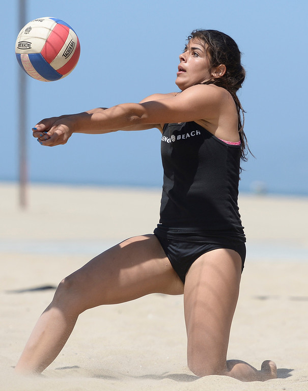 . Emily Bible from Valencia digs out a shot against Huntington Beach during the Interscholastic Beach Volleyball League postseason tournament. Santa Monica, CA. 5/10/2014(Photo by John McCoy / Los Angeles Daily News)