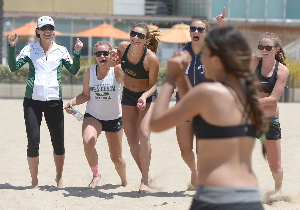 . Mira Costa celebrates a victory over Mater Dei during the Interscholastic Beach Volleyball League postseason tournament. Santa Monica, CA. 5/10/2014(Photo by John McCoy / Los Angeles Daily News)
