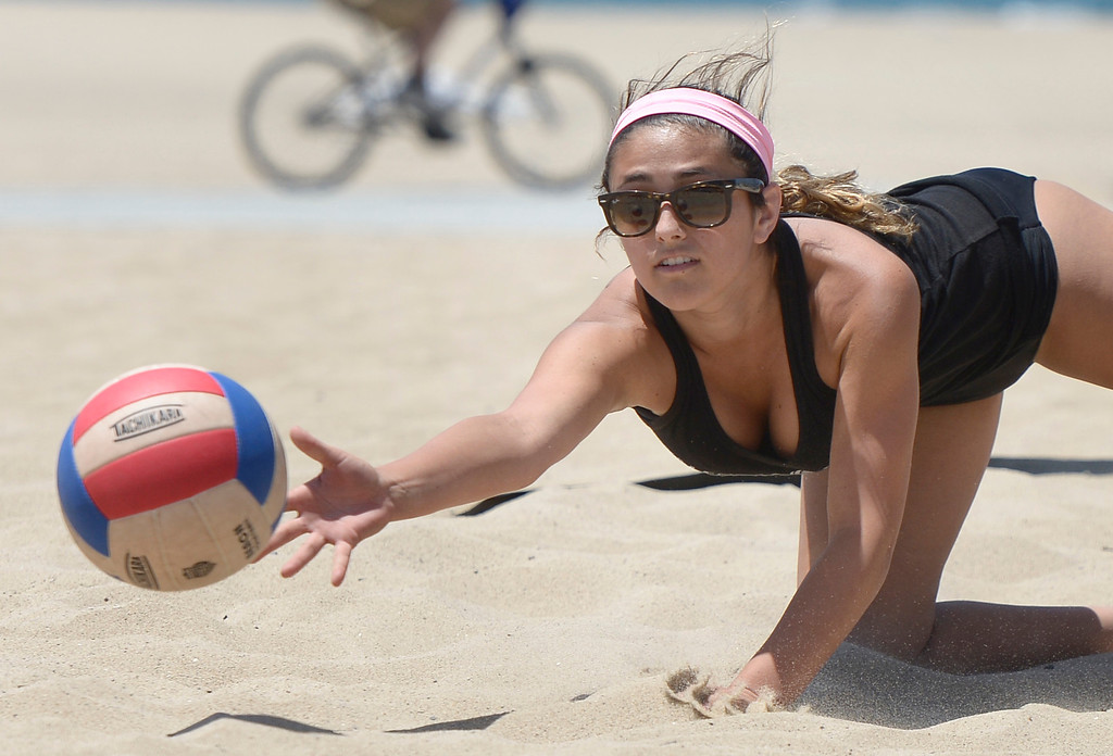 . Demi Dawson from Valencia digs out a ball in a game against Mira Costa during the Interscholastic Beach Volleyball League postseason tournament. Santa Monica, CA. 5/10/2014(Photo by John McCoy / Los Angeles Daily News)