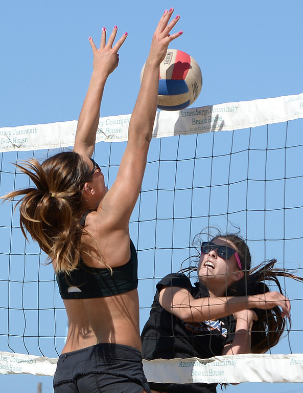 . Skylar Caputo from Mira Costa blocks a shot by Natalie Anselmo from Westlake during the Interscholastic Beach Volleyball League postseason tournament. Santa Monica, CA. 5/10/2014(Photo by John McCoy / Los Angeles Daily News)