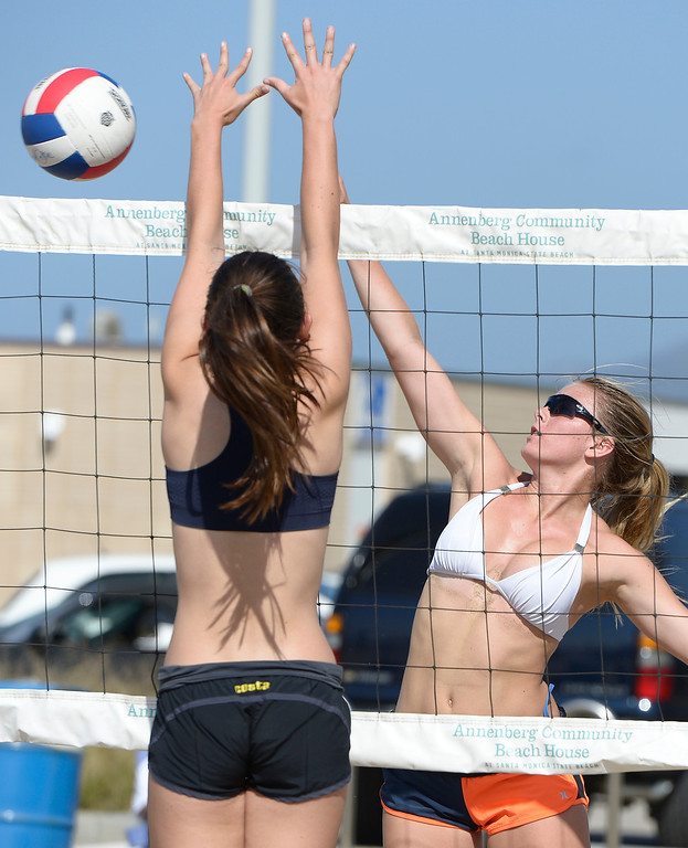 . Lan Nyguyen from Mira Costa can not block this shot by Julia Mannisto from Westlake. Interscholastic Beach Volleyball League postseason tournament. Santa Monica, CA. 5/10/2014(Photo by John McCoy / Los Angeles Daily News)