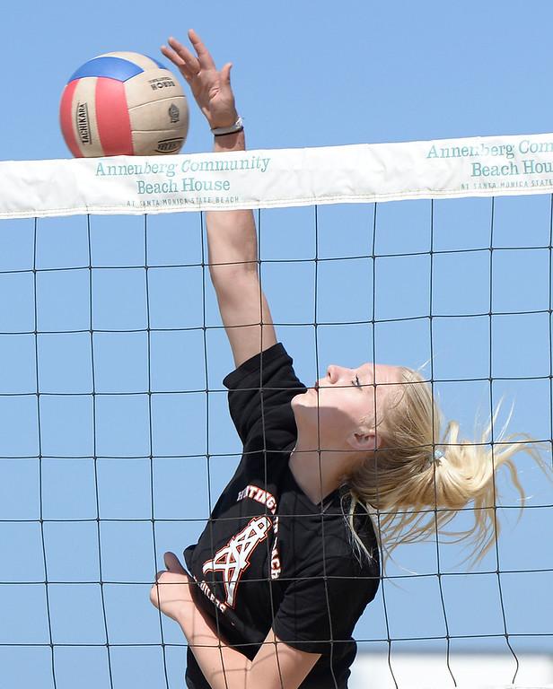 . Aubryn Coale of Huntington Beach spikes the ball against Redondo. Interscholastic Beach Volleyball League postseason tournament. Santa Monica, CA. 5/10/2014(Photo by John McCoy / Los Angeles Daily News)