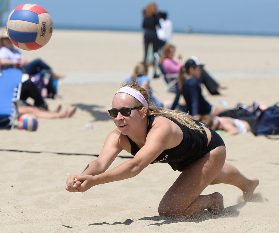 . Kaity Uythoven from Valencia digs out a ball while playing Huntington Beach during the Interscholastic Beach Volleyball League postseason tournament. Santa Monica, CA. 5/10/2014(Photo by John McCoy / Los Angeles Daily News)