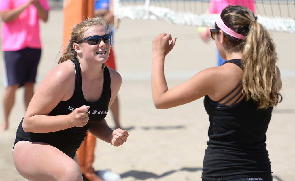 . Kelsey Knudsen and Demi Dawson from Valencia celebrate a victory over Saddleback during the Interscholastic Beach Volleyball League postseason tournament. Santa Monica, CA. 5/10/2014(Photo by John McCoy / Los Angeles Daily News)