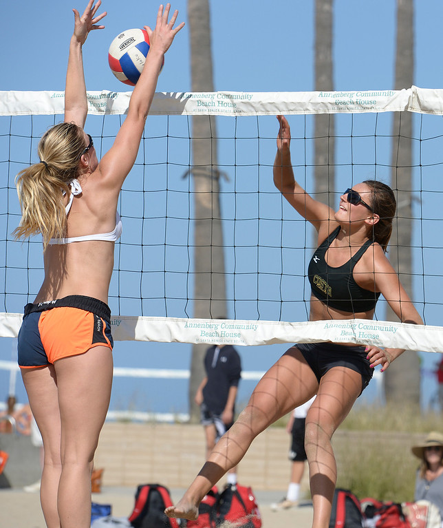 . Julia Mannisto from Westlake goes up to block a shot by Skylar Caputo from Mira Costa. Interscholastic Beach Volleyball League postseason tournament. Santa Monica, CA. 5/10/2014(Photo by John McCoy / Los Angeles Daily News)