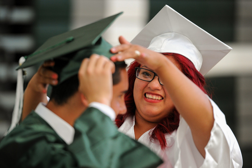 . Marylin Madrigal helps Oswaldo Salcedo with his cap before the Canoga Park graduation, Friday, June 6, 2014. (Photo by Michael Owen Baker/Los Angeles Daily News)