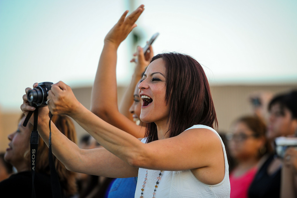 . Family and friends cheer the graduates at the Canoga Park graduation, Friday, June 6, 2014. (Photo by Michael Owen Baker/Los Angeles Daily News)