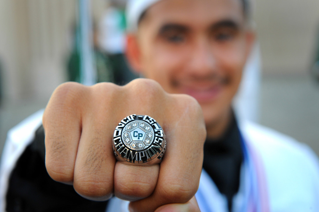 . Giovanni Gomez shows his championship soccer ring before the Canoga Park graduation, Friday, June 6, 2014. (Photo by Michael Owen Baker/Los Angeles Daily News)