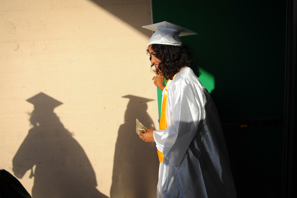. Jazmin Hernandez stands in the gym entrance for cooler air before the Canoga Park graduation, Friday, June 6, 2014. (Photo by Michael Owen Baker/Los Angeles Daily News)