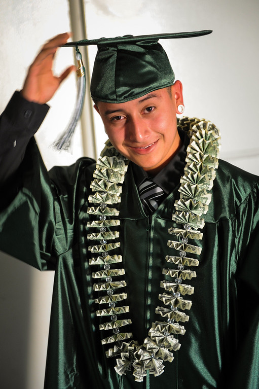 . Carlos Soto-Garcia wears a money lei to the Canoga Park graduation, Friday, June 6, 2014. (Photo by Michael Owen Baker/Los Angeles Daily News)