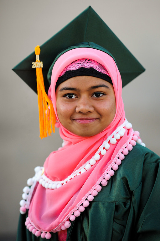 . Jesika Goni waits for the Canoga Park graduation to start, Friday, June 6, 2014. (Photo by Michael Owen Baker/Los Angeles Daily News)