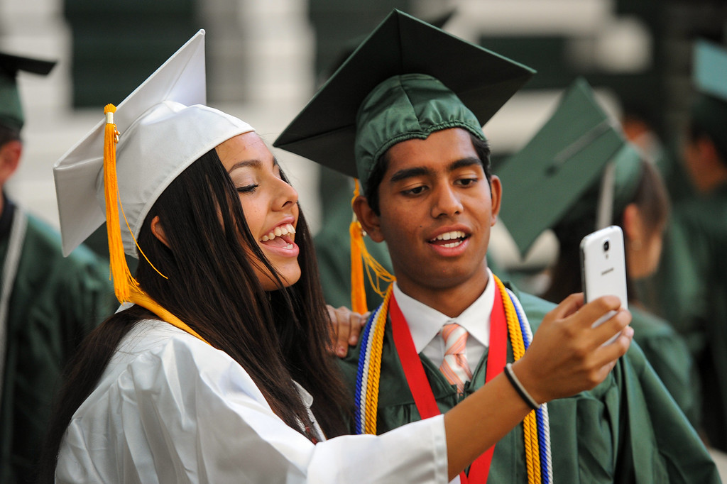 . Ana Acevedo and Aman Azad take a selfie before the Canoga Park graduation, Friday, June 6, 2014. (Photo by Michael Owen Baker/Los Angeles Daily News)