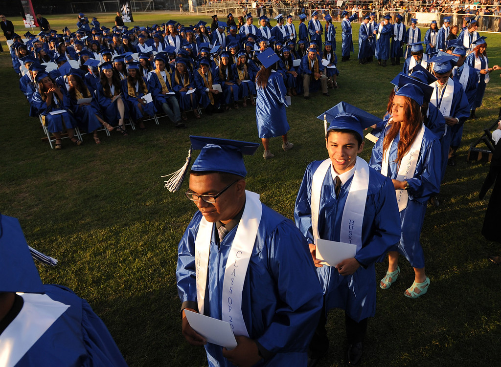 . Grads line up to get their diplomas and shake hands with the Principal at North Hollywood High School graduation for the class of 2014. Los Angeles, CA. 6/6/2014(Photo by John McCoy Daily News)