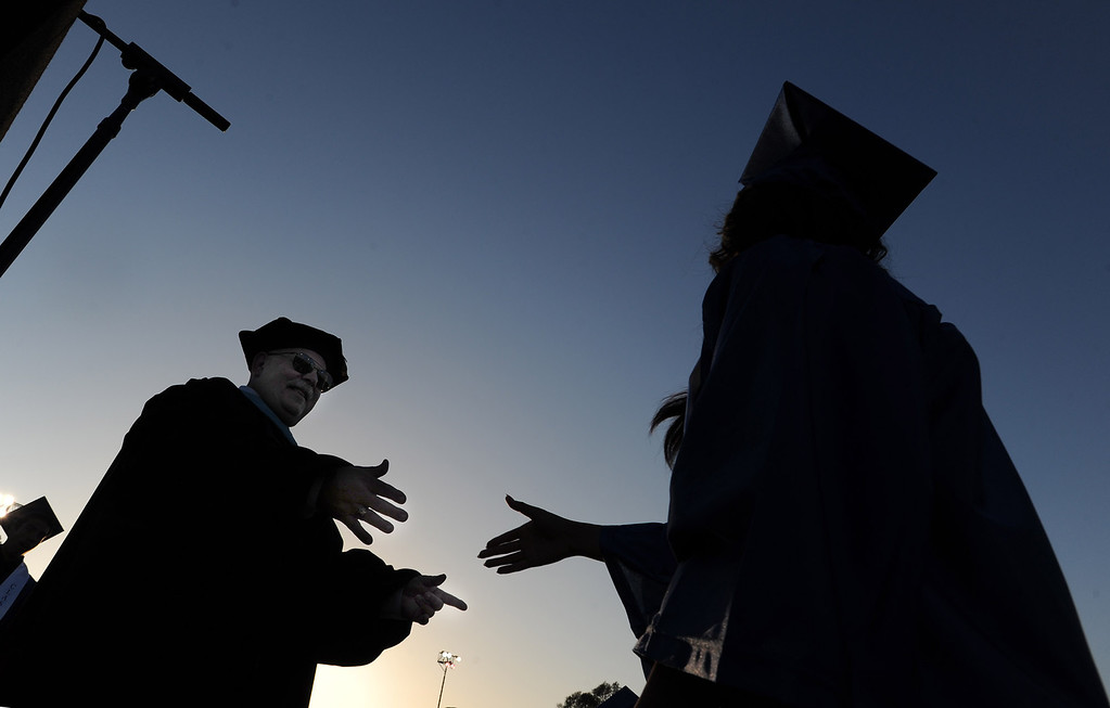 . Dr. Randall Delling, the Principal, shakes hands with the graduates after they received their diplomas at North Hollywood High School graduation for the class of 2014. Los Angeles, CA. 6/6/2014(Photo by John McCoy Daily News)